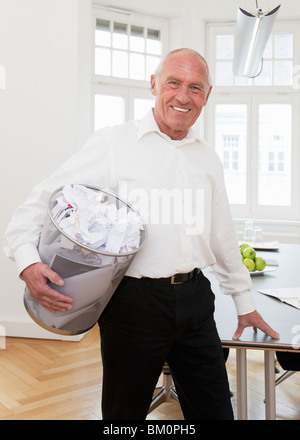 Businessman recycling waste paper - Stock Photo