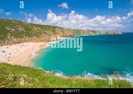 Holidaymakers and tourists sunbathing on Porthcurno beach, Cornwall, England, United Kingdom, Europe - Stock Photo