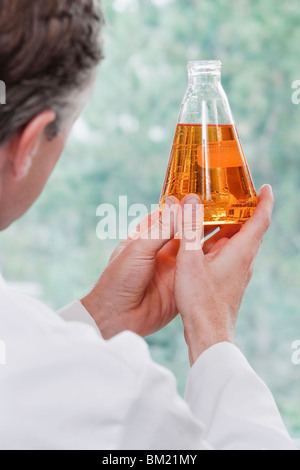 Doctor holding a conical flask in a laboratory - Stock Photo