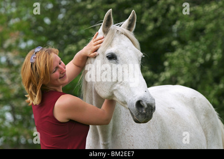 Frau mit Pferd / woman with horse - Stock Photo