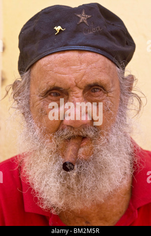 An old man with cap and white beard smoking a cigar, Havana, Cuba, West Indies - Stock Photo