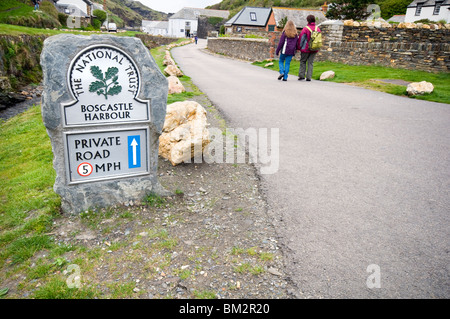 A mother and daughter walking along a path in the coastal village of Boscastle in north Cornwall, England, UK - Stock Photo