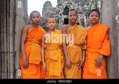 Young monks at Bayon Temple, Angkor Thom near Siem Reap in Cambodia. - Stock Photo