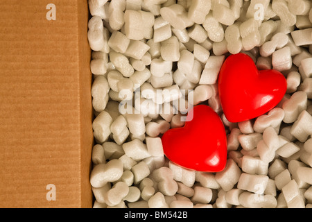valentine's day gift of chocolate candy hearts in a card broad  box - Stock Photo