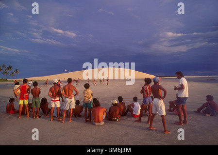 Leisure time. Fishermen play soccer in Jericoacoara beach, Ceara State, Brazil. Daily life in a fishing village. - Stock Photo