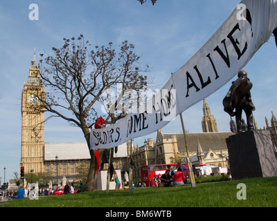 Peace camp of tents and banners set up by various activist groups in Parliament Square London May 2010 - Stock Photo