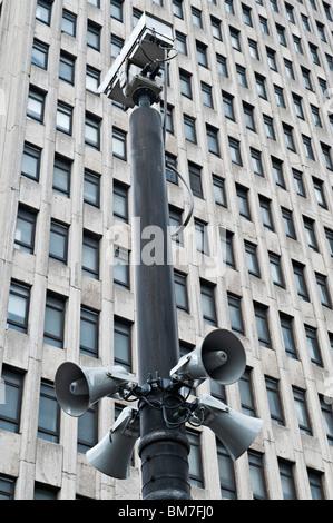 Faceless concrete office block and CCTV camera on Sauchiehall Street, Glasgow, Scotland, UK. - Stock Photo
