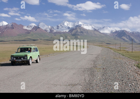 Highway leading to the Mountains near Sary Tash, Kyrgyzstan - Stock Photo