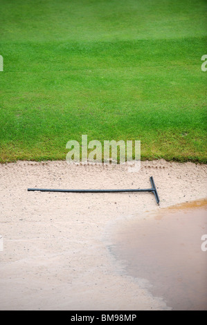A rake in a waterlogged bunker during a downpour at the Celtic Manor Wales Open 2008 the venue for the 2010 Ryder - Stock Photo