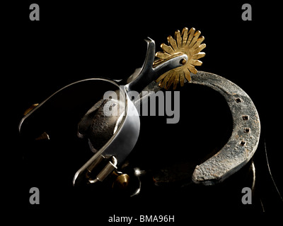 Spur and horse shoe - Stock Photo