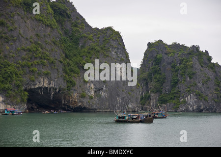 Fishing boat waiting for catch, Halong Bay, Vietnam - Stock Photo