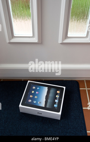 The long awaited Apple iPad is delivered by post. - Stock Photo