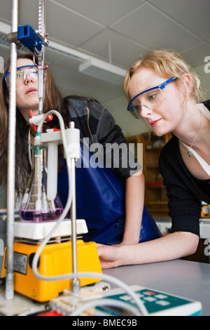 Teacher assisting student in laboratory - Stock Photo