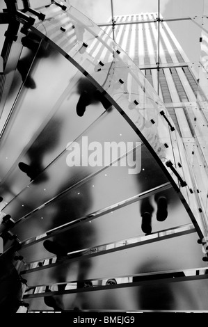 Underneath the clear glass staircase at the entrance of the Apple Store on 5th avenue in New York City, NY, USA. - Stock Photo