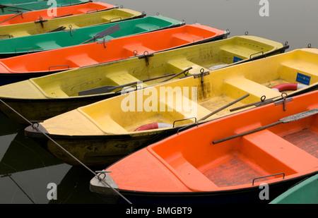 Colourful rowboats in Beihai Park Beijing China - Stock Photo