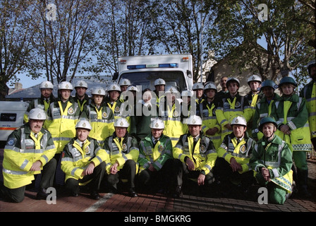 Walthamstowe ambulance crew posing for a picture after mock emergency evacuation in underground station London England - Stock Photo