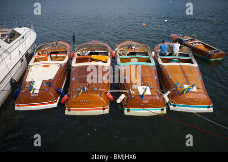 View of row of boats with two men, elevated view - Stock Photo