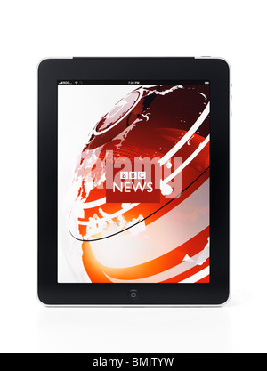 Apple iPad 3G tablet computer with BBC news application on its display isolated on white background with clipping - Stock Photo