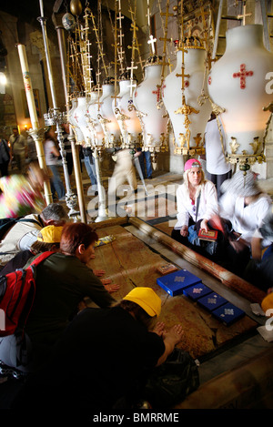 Stone of unction at church of The Holy Sepulchre in Jerusalem - Stock Photo