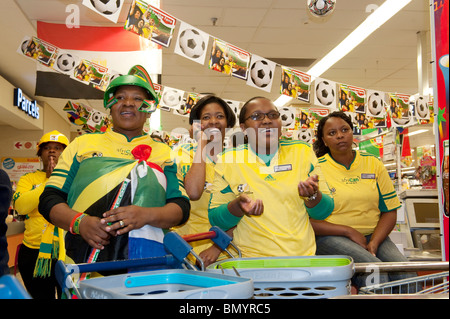 Employees of a supermarket watching a match of the FIFA World Cup 2010 in Cape Town South Africa - Stock Photo