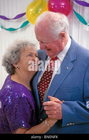 60 to 70 Caucasian year old olds happy Senior couple celebrate their 50th wedding anniversary.in home United States - Stock Photo