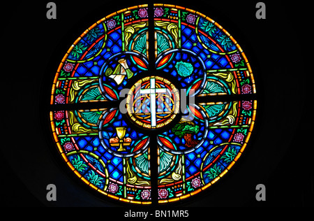 Traditional stained glass window at Wesley United Methodist Church at St Simon's Island, Georgia, United States - Stock Photo