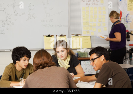 High school students studying together in class - Stock Photo