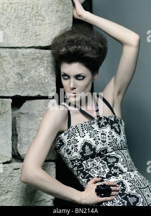 High fashion photo of a beautiful woman wearing elegant dress - Stock Photo
