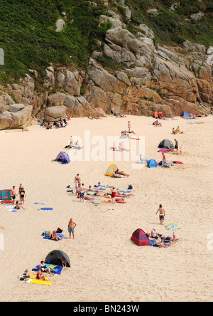 holiday makers on the beach at porthcurno in cornwall, uk - Stock Photo