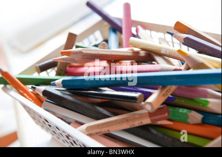 Coloured pencils in a basket, close-up - Stock Photo