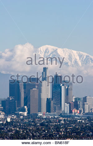 Los Angeles Skyline with Snowy Mount Baldy in Background, California - Stock Photo