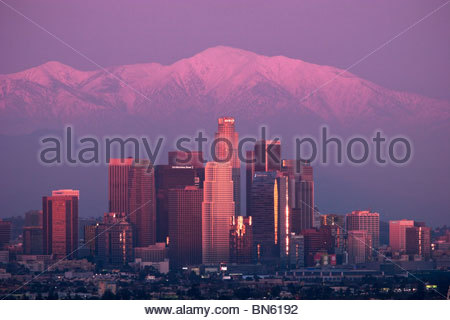 Downtown Los Angeles Skyline Winter Sunset with Mount Baldy in Background, California - Stock Photo