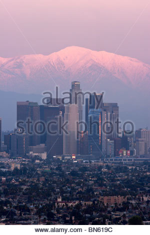 Los Angeles Skyline and Snowy Mount Baldy in Background, Southern California - Stock Photo