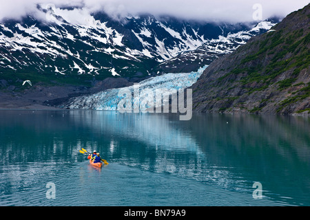 Family kayaking in Shoup Bay with Shoup Glacier in the background, Prince William Sound, Alaska - Stock Photo
