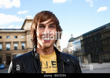 Portrait of a happy young man - Stock Photo