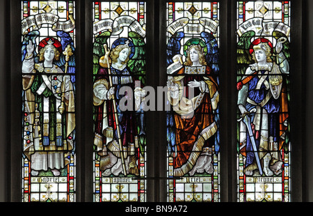Detail from a stained glass window depicting the Archangels Gabriel, Raphael, Uriel and Michael - Stock Photo