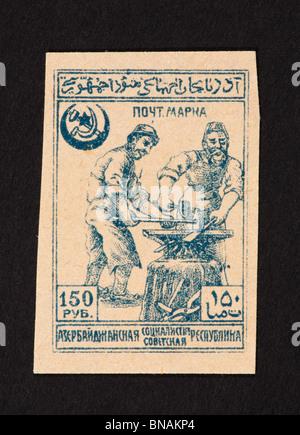 Postage stamp from Azerbaijan depicting blacksmiths. - Stock Photo