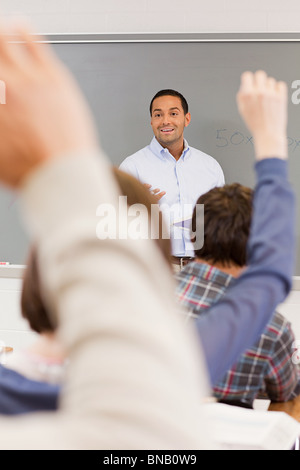 High school students and teacher in classroom - Stock Photo