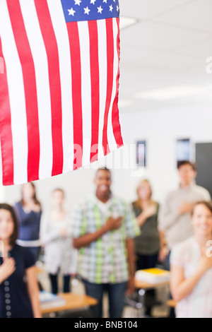 High school students swearing allegiance to the American flag - Stock Photo
