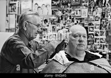 Russell Hiatt Cutting Hair in Flyd's City Barber Shop in Mount Airy, North Carolina - Stock Photo