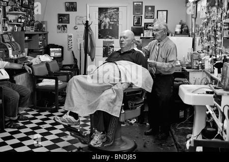 Russell Hiatt Cutting Hair in Floyd's City Barber Shop in Mount Airy, North Carolina - Stock Photo