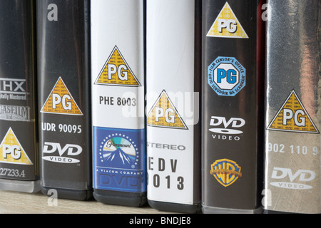 row of dvd video cases showing BBFC and irish film censors office PG classification notice from the uk - Stock Photo