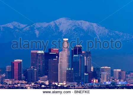 Downtown Los Angeles Skyline at Night with Mount Baldy in Background, Southern California - Stock Photo