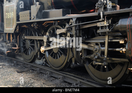 Mechanical drive rods on a steam loco - Stock Photo