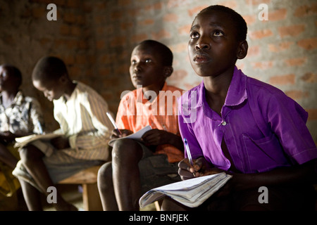 Primary school children learn in a classroom in Amuria, Eastern Uganda. - Stock Photo