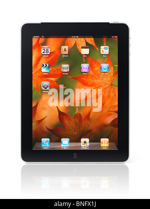 Apple iPad 3G tablet with desktop icons and autumn theme background on its display isolated on white background - Stock Photo