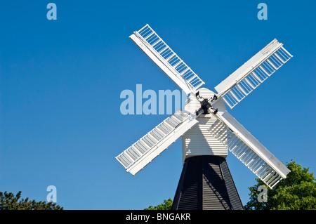 Horizontal close up of the Wimbledon Windmill on a bright sunny day. - Stock Photo