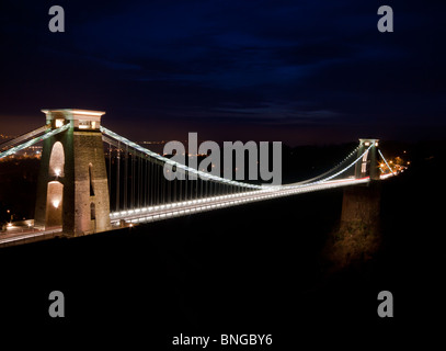 A night time shot of an illuminated Clifton Suspension Bridge, Bristol. This iconic bridge was designed an d constructed - Stock Photo