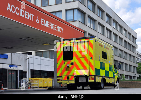 NHS SOS uk emergency ambulance at a London A&E National Health Service hospital entrance for Accident & Emergency - Stock Photo