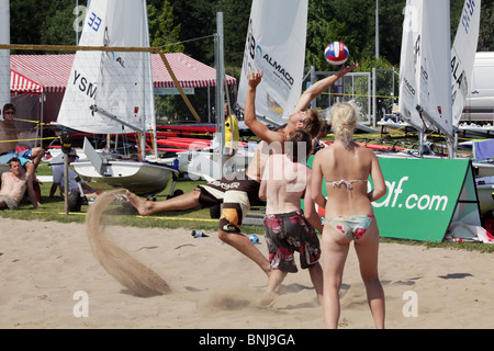 Sailors and fans play beach volleyball NatWest Island Games 2009 Eastern Harbour of Mariehamn on Åland, July 2 2009 - Stock Photo